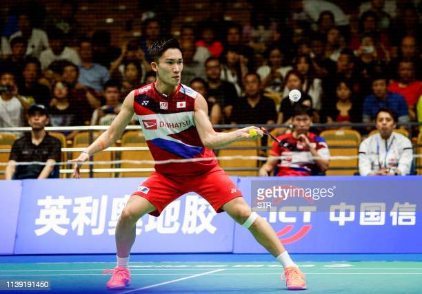 Kento Momota of Japan hits a return against Lee Cheuk Yiu of Hong Kong during their men's singles second round match at the 2019 Badminton Asia...