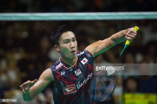 Kento Momota of Japan hits a return against Lee Chong Wei of Malaysia during their men's singles semifinals match at the 2018 Badminton Asia...