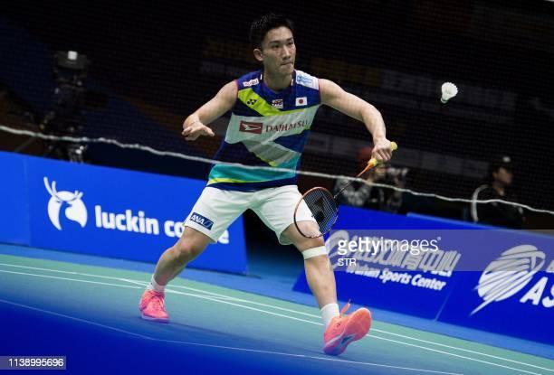 Kento Momota of Japan hits a return against Lee Dongkeun of South Korea during their men's singles first round match at the 2019 Badminton Asia...