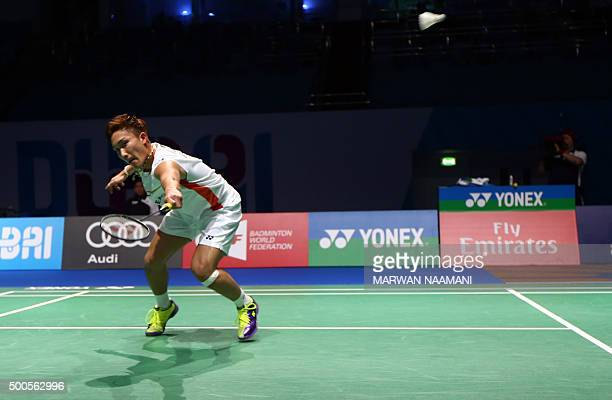 Kento Momota of Japan hits a return against Srikanth Kidambi of India in the men's singles match during the Dubai World Superseries Finals badminton...