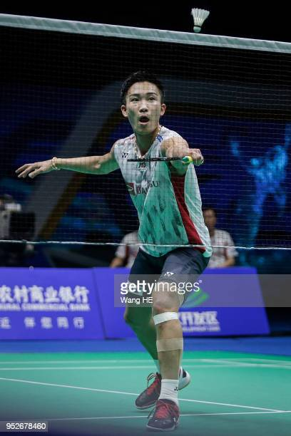 Kento Momota of Japan hits a return during man's singles final match against Chen long of China at the 2018 Badminton Asia Championships on Apirl 29...