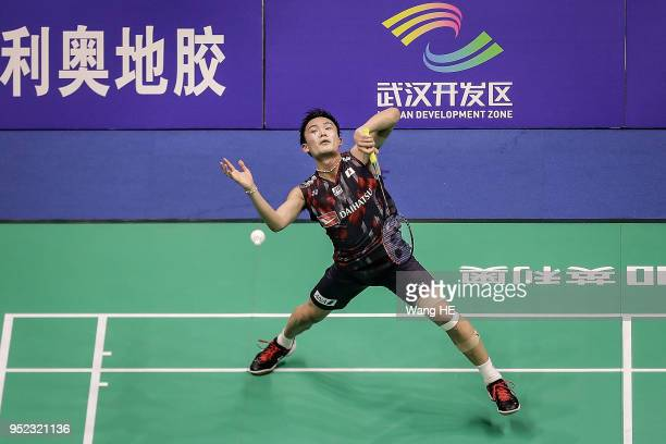 Kento Momota of Japan hits a return during singles semi final match against Lee Chong Wei of Malaysia at the 2018 Badminton Asia Championships on...
