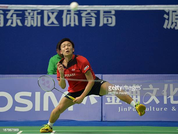 Kento Momota of Japan hits a return to Kashyap Parupalli of India in the men's singles second round at the China Open badminton tournament in...