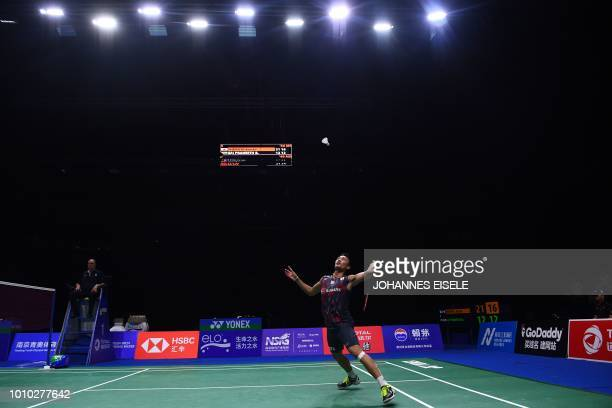Kento Momota of Japan hits a shot against Sai Praneeth of India in their men's single quarter final match during the badminton World Championships in...
