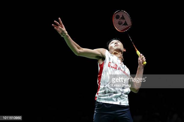 Kento Momota of Japan hits a shot against Shi Yuqi of China in the men's singles final on day 7 of Total BWF World Championships at Nanjing Youth...