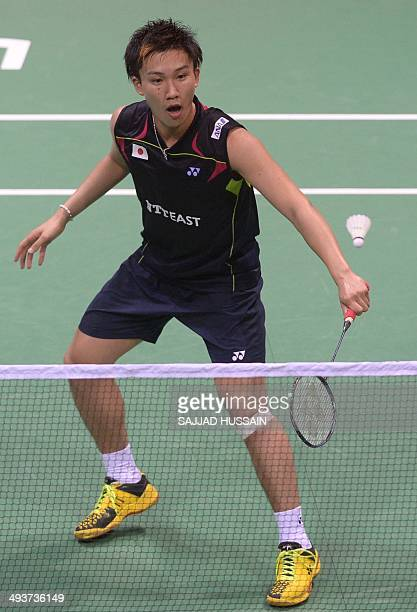 Kento Momota of Japan plays a return to Chong Wei Feng of Malaysia during their Thomas Cup badminton final match at Siri Fort Stadium in New Delhi on...