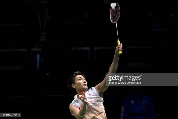 Kento Momota of Japan plays during his match against Tien Chen Chou of Chinese Taipei during the men's singles match at the quarter-finals between...