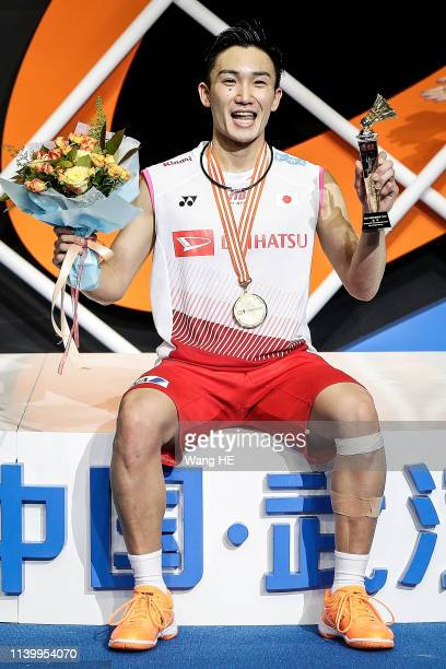 Kento Momota of Japan pose with gold medals on the podium after winning the men's singles final match against Shi Yuqi of China at the 2019 Badminton...