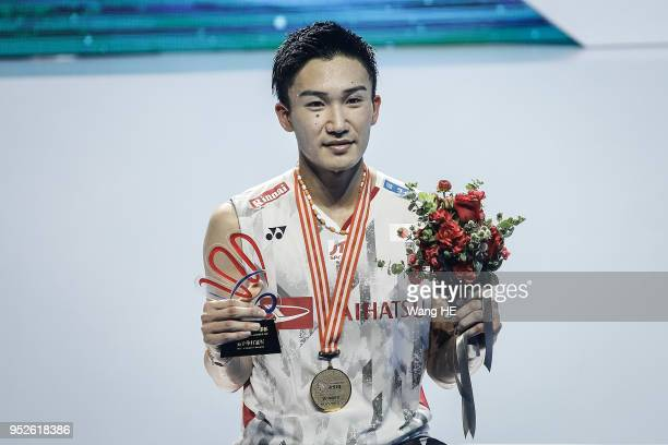 Kento Momota of Japan pose with his gold medal after winning the men's singles final against Chen long of China at the 2018 Badminton Asia...