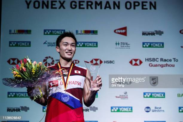 Kento Momota of Japan pose with his trophy after the Men's Single final match against Kenta Nishimoto of Japan during day six of the Yonex German...