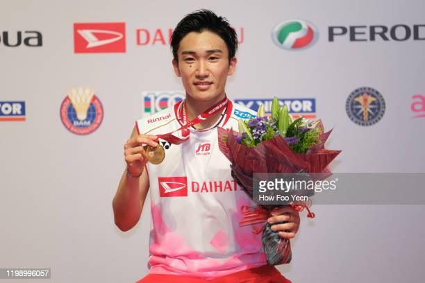 Kento Momota of Japan poses his medal after defeating Viktor Axelsen of Denmark during the men's single finals at the Perodua Malaysia Masters 2020...