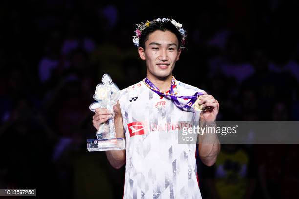 Kento Momota of Japan poses on podium after winning the men's singles final against Shi Yuqi of China on day seven of TOTAL BWF World Championships...