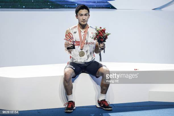 Kento Momota of Japan poses with his gold medal after winning the men's singles final against Chen long of China at the 2018 Badminton Asia...
