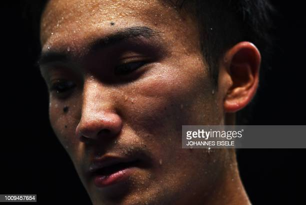 Kento Momota of Japan reacts after a shot against Anders Antonsen of Denmark in their men's singles match during the badminton World Championships in...
