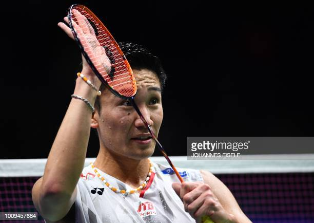 Kento Momota of Japan reacts after defeating Anders Antonsen of Denmark in their men's singles match during the badminton World Championships in...