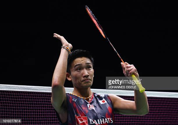 Kento Momota of Japan reacts after defeating Sai Praneeth of India in their men's single quarterfinal match during the badminton World Championships...