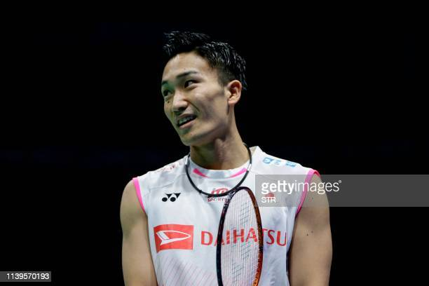Kento Momota of Japan reacts during his men's singles semifinal match against Tien Minh Nguyen of Vietnam at the 2019 Badminton Asia Championships in...