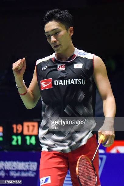 Kento Momota of Japan reacts in the Men's Singles final match against Anthony Sinisuka Ginting of Indonesia on day six of 2019 China Badminton Open...