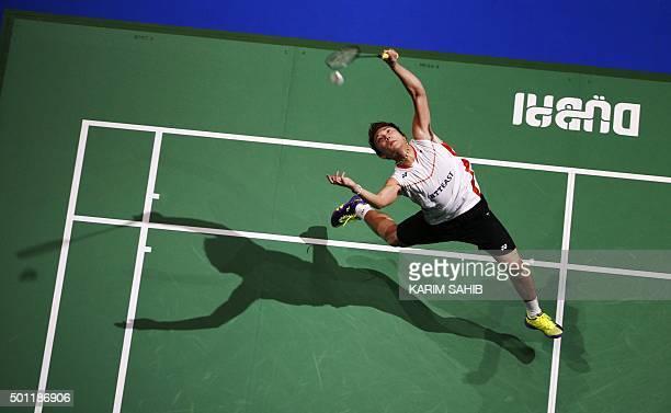 Kento Momota of Japan returns a shot against Viktor Axelsen of Denmark during their men's single final match in the Dubai World Superseries Finals...