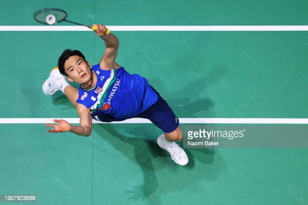 Kento Momota of Japan returns a shot during his Quarter Final match against Lee Zii Jia of Malasyia during day three of YONEX All England Open...