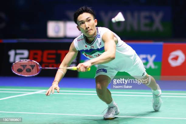 Kento Momota of Japan returns a shot during his round of 16 match against Prannoy H. S. During day two of YONEX All England Open Badminton...