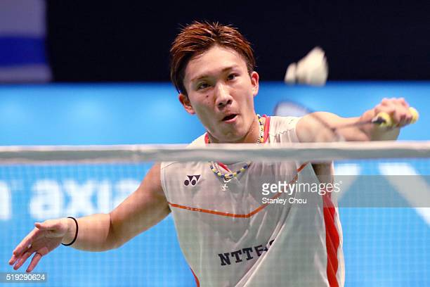 Kento Momota of Japan returns to HS Prannoy of India during round one of the BWF World Super Series Badminton Malaysia Open at Stadium Malawati on...