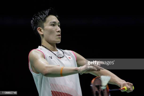 Kento Momota of Japan serves against Shi Yuqi of China during their men's singles final match at the 2019 Badminton Asia Championships in Wuhan...