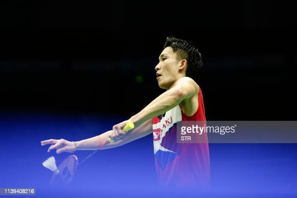 Kento Momota of Japan serves to Lu Guangzu of China during their men's singles quarterfinal match at the 2019 Badminton Asia Championships in Wuhan...