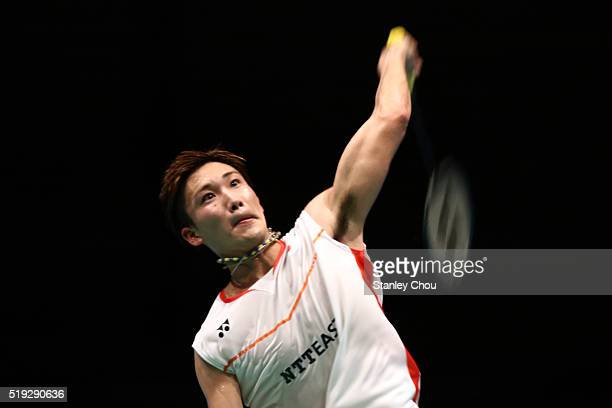Kento Momota of Japan smashes against HS Prannoy of India during round one of the BWF World Super Series Badminton Malaysia Open at Stadium Malawati...