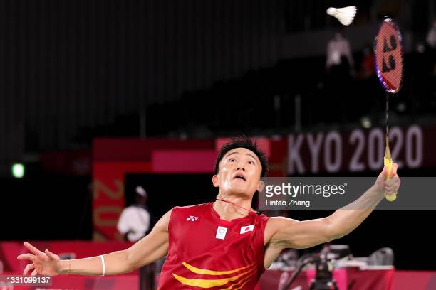 Kento Momota of Team Japan competes against Heo Kwanghee of Team South Korea during a Men's Singles Group A match on day five of the Tokyo 2020...