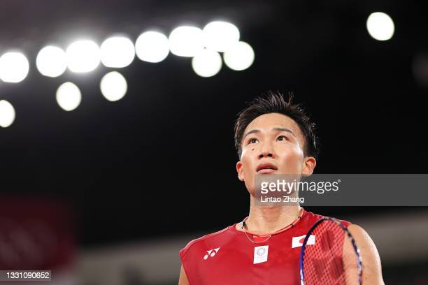 Kento Momota of Team Japan reacts as he competes against Heo Kwanghee of Team South Korea during a Men's Singles Group A match on day five of the...