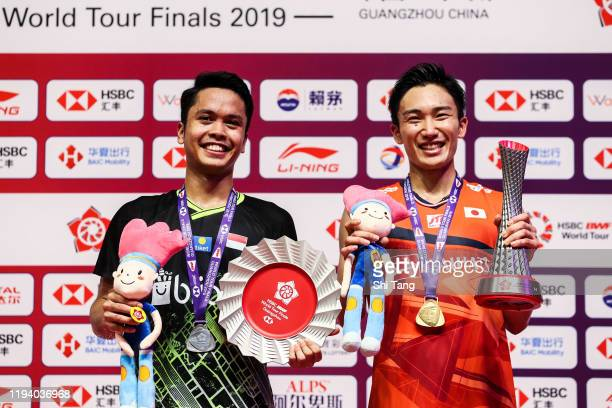 Kento Momotaof Japan and Anthony Sinisuka Ginting of Indonesia pose with their trophies after the Men's Single final match during day five of the...