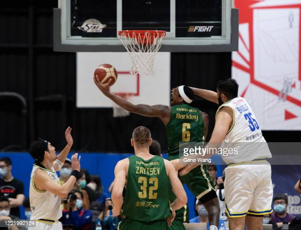 Kentrell Barkley of Taiwan Beer attempts the basket under heavy defense during the SBL Finals Game Six between Taiwan Beer and Yulon Luxgen Dinos at...