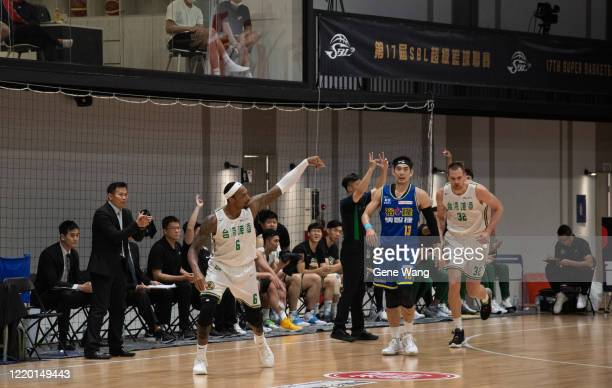 Kentrell Barkley of Taiwan Beer cheers for himseld after made a three point shot during the SBL Finals Game One between Taiwan Beer and Yulon Luxgen...