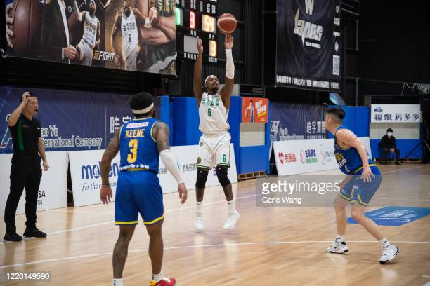 Kentrell Barkley of Taiwan Beer made a three point shot during the SBL Finals Game One between Taiwan Beer and Yulon Luxgen Dinos at Hao Yu Trainning...