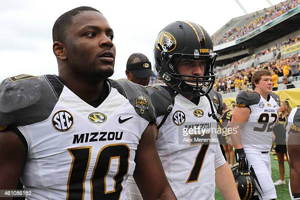 Kentrell Brothers and Maty Mauk of the Missouri Tigers walk off the field at halftime during the Buffalo Wild Wings Citrus Bowl against the Minnesota...