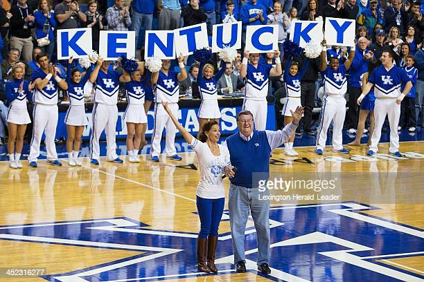 Kentucky alumnae Ashley Judd left and former UK head coach Joe B Hall are acknowledged during a time out in the second half against Eastern Michigan...