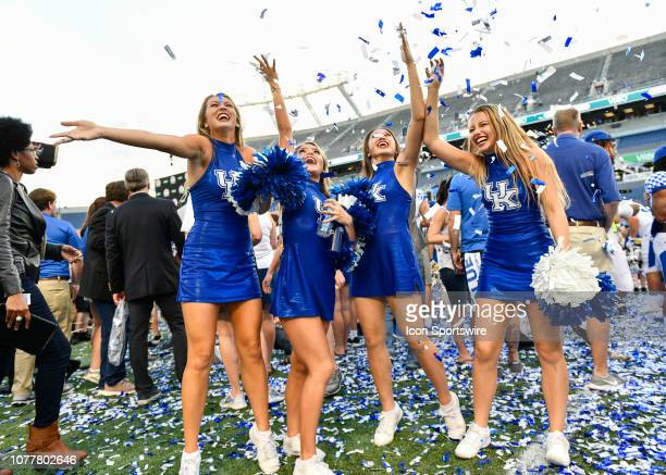 Kentucky cheerleaders celebrate after the awards ceremony of the Citrus Bowl between the Kentucky Wildcats and the Penn State Nittany Lions on...