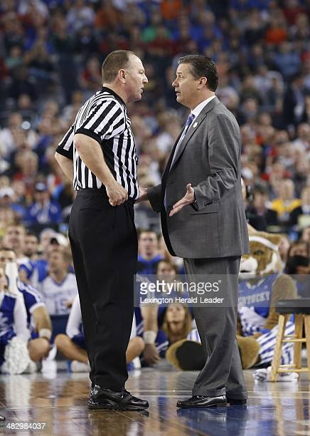 Kentucky Coach John Calipari has a word with an official during first half action as the Kentucky Wildcats faced the Wisconsin Badgers in the second...