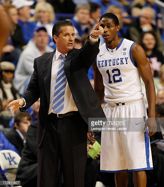 Kentucky coach John Calipari left talks to guard Brandon Knight in action against Boston University at Rupp Arena in Lexington Kentucky on Tuesday...