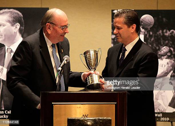 Kentucky coach John Calipari receives the Adolph Rupp National Coach of the Year award on Thursday April 1 in Indianapolis Indiana from Herky Rupp...