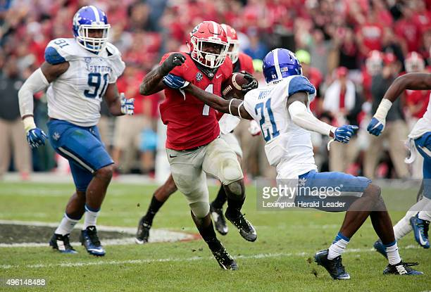 Kentucky defensive back Chris Westry reaches back for unsuccessful arm tackle attempt on Georgia running back Sony Michel in the third quarter on...