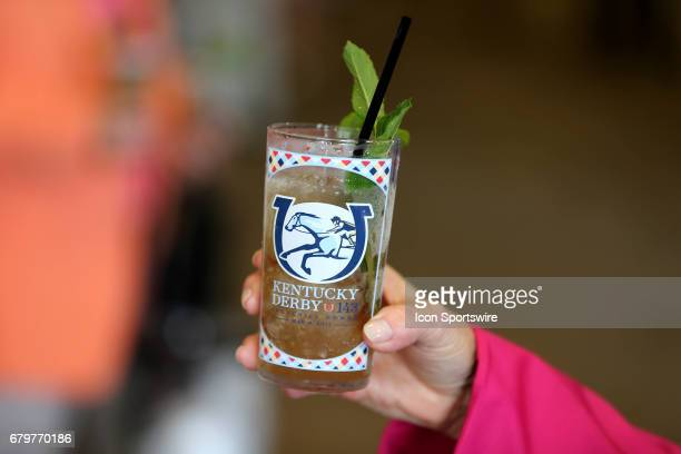Kentucky Derby fans show off a Mint Julep prior to the running of the 143rd Kentucky Derby on May 06 2017 at Churchill Downs in Louisville Kentucky