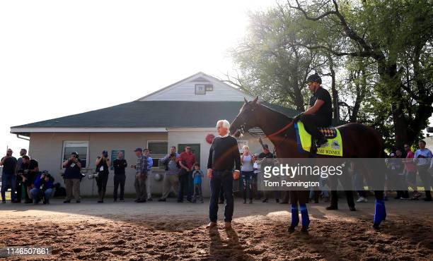 Kentucky Derby Trainer Bob Baffert looks on as Game Winner takes the track for morning workouts in preparation for the 145th running of the Kentucky...