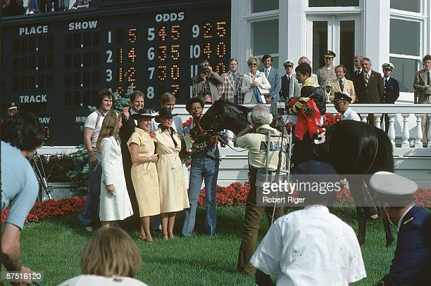 Kentucky Derby winner Seattle Slew and jockey Jean Cruguet pose in the winner's circle at Churchill Downs Louisville Kentucky May 7 1977 Trainer...