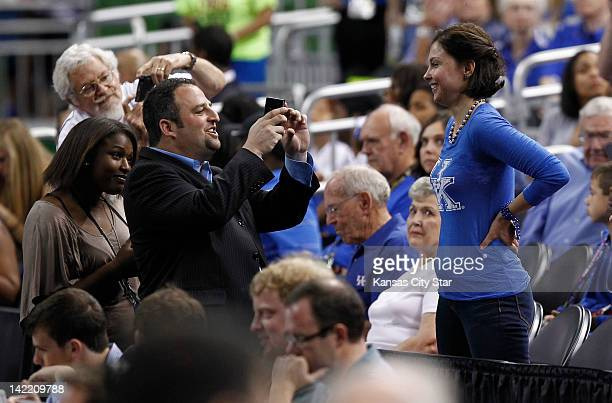 Kentucky fan and actress Ashley Judd poses for photos prior to the game against Louisville in the NCAA Tournament semifinals at the MercedesBenz...