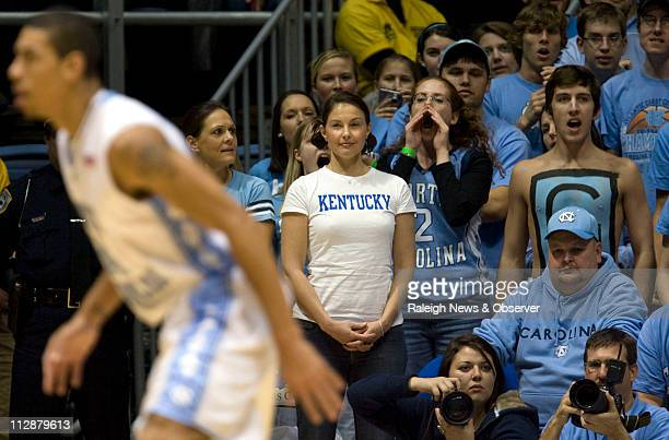 Kentucky fan Ashely Judd stands in the North Carolina student section during the first half of the game between the North Carolina an Kentucky at the...