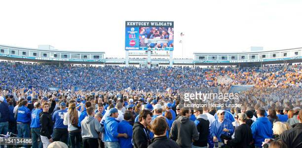 Kentucky fans swarm the field after a victory over Tennessee on Saturday November 16 in Lexington Kentucky