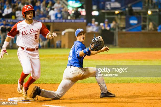Kentucky first baseman Evan White looks over his shoulder at a missed throw during the College World Series Lexington Regional baseball game between...