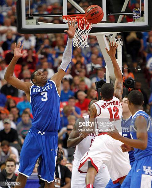 Kentucky forward Terrence Jones blocks the shot of Alabama guard Trevor Releford during game action in the semifinals of the SEC Tournament Kentucky...